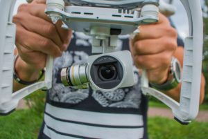 Image shows amateur photographer using drone to take aerial photos & pics, the changing face of Photography