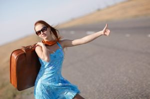 Travel & Transport, Image shows pretty young female hitch-hiker thumbing a lift.