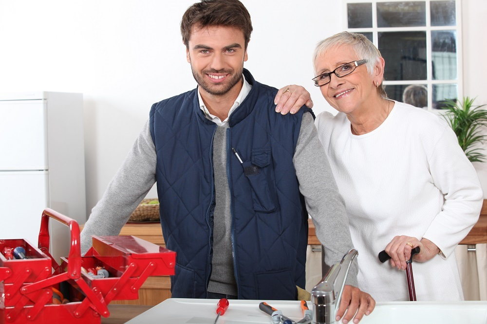 Image of Handyman Plumber helping pensioner Fix a Leaking Tap with Help for Hire